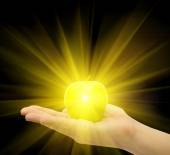 Shinny golden apple on the palm in isolated background — Stock Photo