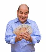 A fat bald head office guy businessman is holding pile of Thai banknotes money with his greedy face sweating. It's a moment of wealth and rich. — Stock Photo