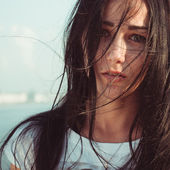 Young woman with mess black long hair portrait close up  — Stock Photo