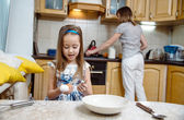 Making breakfest. Little mother's helper — Stock Photo