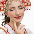 Smile young woman hands on hips portrait in russian traditional costume -- red sarafan and kokoshnik. — Stock fotografie #72248705