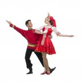 Couple of dancers in russian traditional costumes, embracing on dance pose .  — Stock Photo
