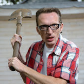 Angry farmer with spade — Stock Photo
