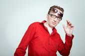 Amazed man at two pairs of eyeglasses — Stock Photo