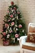 Christmas decorated tree  on the white brick wall background — ストック写真