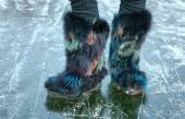Winter furry shoes on the ice surface — Foto de Stock