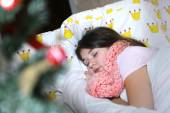 Beautiful teen girl with long dark hair sick in bed  — Stock Photo