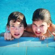 Preteen siblings boy and girl in open air  swimming pool in egyp — Stock Photo #63426153