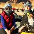 Brother and sister childern in quad bike safari trip into desert — Stock Photo #63426201