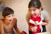Naughty brother and sister dress cat in santa klaus costume — Stock Photo