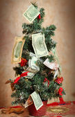 Dollars and euto bill as christmas tree decoration — Stock Photo