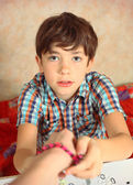 Preteen hansome boy show  the result of his rainbow loom hobby b — Stock Photo
