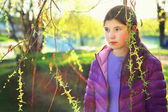 Thoutful portrait of teenager beautiful girl on the spring park — Stock Photo