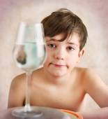 Keen preteen boy investigate reflection behavior in water — Stock Photo
