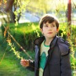 Thoutful portrait of preteen handsome boy on the spring park bac — Stock Photo #75200591