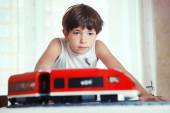 Preteen handsome boy play with meccano toy train and railway sta — Stock Photo