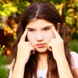 Teen girl with myopia try to see something far away — Stock Photo #77461928