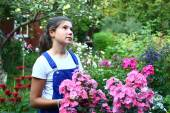 Teen beautirul girl in the blossoming summer garden — Stock Photo