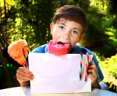Boy with cotton candy and sheet of paper — Stock Photo