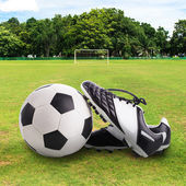 Soccer ball and soccer shoes — Stock Photo
