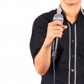 Male hand holding microphone — Stock Photo