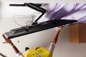 Man installing mount TV  — Stock Photo