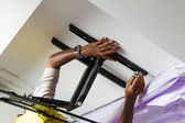 Man installing mount TV  — Stock Photo