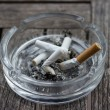 Ashtray Full of Cigarettes burnt butts — Stock Photo #52681713