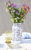 Still life with a vase of flowers — Stock Photo
