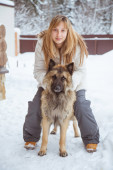 Girl with a shepherd dog in winter backgrounds — Foto Stock