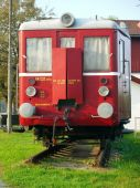Old red train waggon at piece of rail — Stock Photo