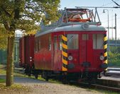 Displaced old red train electric waggon — Stock fotografie
