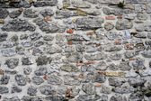 Ancient multicolored stone fortress wall — Стоковое фото