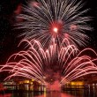 Colorful fireworks explode in Malta in dark sky,Malta fireworks festival, 4 July, Independence day, fireworks explode, New Year, fireworks in Valletta isolated in dark background with place for text — Stock Photo #75885241