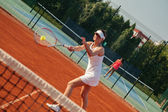 Attractive Female Tennis Player Playing a Match — Stock Photo