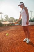 Attractive Female Tennis Player Hitting A Ball — Stock Photo