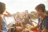 Friends Enjoying On A Boat — Photo