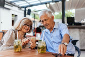Mature Couple In Cafe Using Technology — Stock Photo