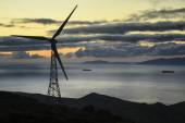 A wind turbines at sunset in an eolic park — Stock Photo