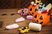 Candies with pumpkins in Halloween festivities — Stock Photo