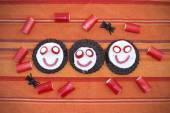 Smiling cookies with candies in Halloween festivities — Stock Photo