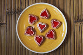 Red hearts cookies on wooden background — Stock Photo