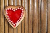 Red heart cookie on wooden background — Stock Photo