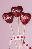 Three red hearts with the word Love — Stockfoto