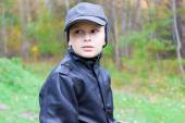 Chil boy pensive thoughtful look forest fall — Stock Photo