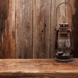 Lamp oil lantern retro barn wooden background — Stock Photo #64529923