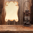 Lamp oil lantern certificate old wooden table wall — Stock Photo #64922805