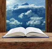Bible open book  wooden window sky view stormy cloud — Foto Stock