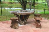 Wooden table and chairs in the garden — Photo