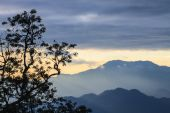 clouds with silhouetted mountians — Stock Photo